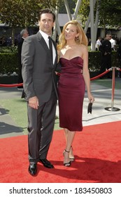 Jon Hamm, in a Lanvin tuxedo, Jennifer Westfeldt, in a L'Wren Scott dress, at 2009 Creative Arts EMMY AWARDS ,Nokia Theatre, Los Angeles September 12, 2009