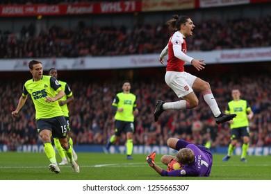 Jonas Lossl of Huddersfield Town gathers up the ball from Hector Bellerin of Arsenal - Arsenal v Huddersfield Town, Premier League, Emirates Stadium, London (Holloway) - 8th December 2018