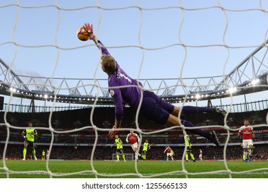 Jonas Lossl of Huddersfield Town makes a flying save to deny Lucas Torreira of Arsenal - Arsenal v Huddersfield Town, Premier League, Emirates Stadium, London (Holloway) - 8th December 2018