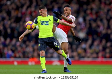 Jonathan Hogg of Huddersfield Town holds off Pierre-Emerick Aubameyang of Arsenal - Arsenal v Huddersfield Town, Premier League, Emirates Stadium, London (Holloway) - 8th December 2018