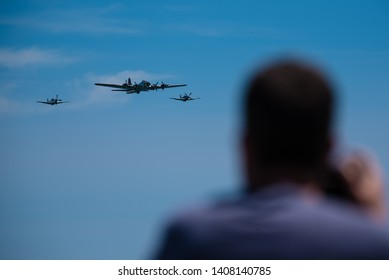 Jones Beach, New York, May 25, 2019: Jones Beach Air Show 2019. Three warbird planes are flying toward spectators on the beach.
