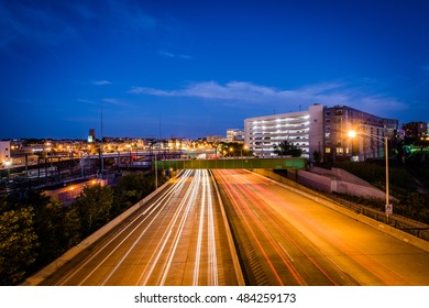 The Jones Falls Expressway at night, seen from the Howard Street Bridge, in Baltimore, Maryland.