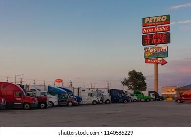 JOPLIN, MISSOURI - JULY, 8 2018 - Joplin 44 Petro truckstop with semi-trailer trucks parked.