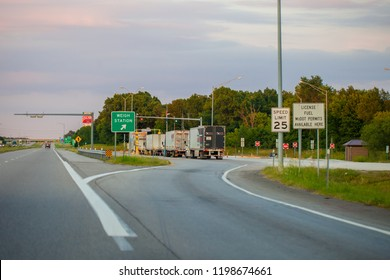 JOPLIN, MISSOURI, USA - JULY 8, 2018 -  Weigh Station checkpoint on Interstate I-44 with commercial vehicles in line to be weighted.