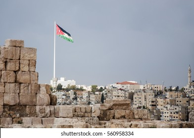 Jordan flag in Amman - In the winter season and clouds loaded with rain