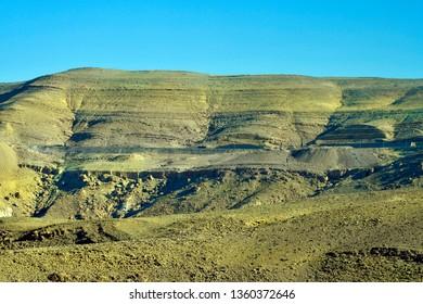 Jordan, mountain road in arid and treeless landscape