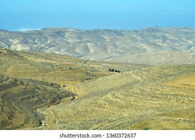 Jordan, mountain road through arid and treeless landscape