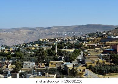 Jordan, mountain village Al-Tayba with buildings and mosque