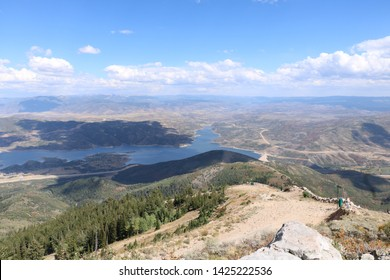 Jordanelle Reservoir with the countryside of Wasatch County as seen from the summit of Bald Mountain at Deer Valley resort in Park City, Utah.