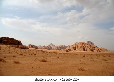 Jordanian desert in Wadi Rum, Jordan. Wadi Rum has led to its designation as a UNESCO World Heritage Site. It is known as The Valley of the Moon