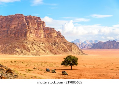 Jordanian desert in Wadi Rum, Jordan viewed from Lawrence's Spring.  Wadi Rum is known as The Valley of the Moon and has led to its designation as a UNESCO World Heritage Site.