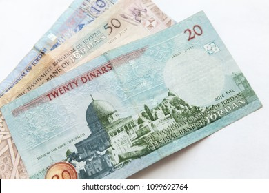 Jordanian dinars, banknotes lay on a white background