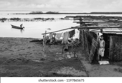 JORHAT, INDIA - AUGUST 23, 2011: Flooding along the Brahmaputra river threatening to engulf shacks and people  during monsoon on August 23, 2011, Jorhat, Assam, India.