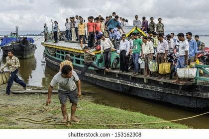 JORHAT, INDIA - AUGUST 23: Over crowded ferry arrives at Nimatighat having crossed the Brahmaputra from Majuli on August 23, 2011 near Jorhat, Assam, India.