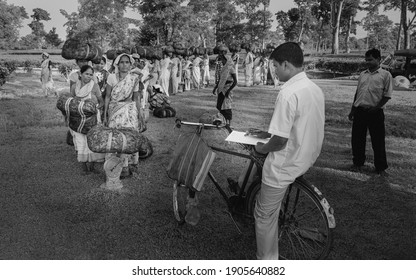 JORHAT, INDIA - AUGUST 30, 2011: Women queue patiently to have their bundles of harvested tea leaves weighed at end of working day on August 30, 2011 in Jorhat, Assam, India.