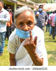 Jorhat,Assam,India-27 March 2021: A eighty years old woman shows her  finger marked with indelible ink after casting her  vote in  Jorhat.
