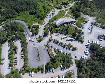 JORPELAND, NORWAY-CIRCA JUL, 2018: Buses and cars are in the paid parking area of Pulpit Rock on Preikestolvegen. Top view. Start point of hiking route to Preacher's Pulpit (Preikestolen)