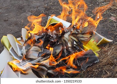 Joss paper and ghost money are being burned in Chinese tradition with the belief the spirit of ancestors or of the deceased will have good things to live and use in their afterlife. Chinese funerals.