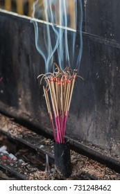 Joss sticks burning with smoke in a temple