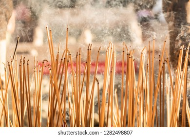 joss sticks burning at a vintage Buddhist temple courtyard as offering during Chinese New Year in temple