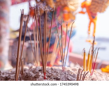 Joss sticks at the Chao Pho Khao Yai Shrine, a Chinese style Buddhist temple on Ko Sichang, an island off the coast of Chonburi Province in Thailand. Shallow depth of field.