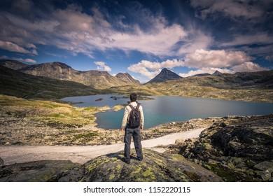 Jotunheimen National Park - July 29, 2018: Traveler in the wild mountain landscape in the Jotunheimen National Park, Norway