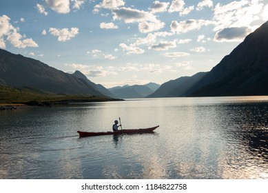 JOTUNHEIMEN NATIONAL PARK, NORWAY - 27 JULY, 2018: man kayaking at Gjende lake, Besseggen ridge, Jotunheimen National Park, Norway