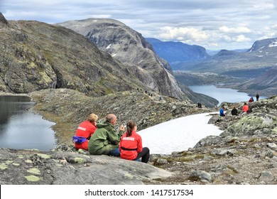 JOTUNHEIMEN, NORWAY - AUGUST 1, 2015: People hike at Besseggen trail in Jotunheimen National Park, Norway. Norway had almost 5 million foreign visitors in 2011.