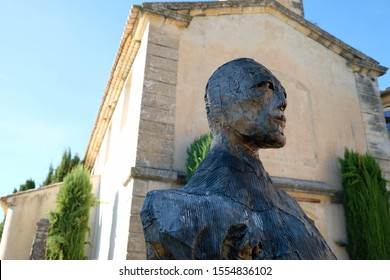 Joucas. Luberon. Provence. France. October 05. 2019. Fragment of a sculpture of a giant man made of wood and metal on an ancient church. Man's look. France tourism.