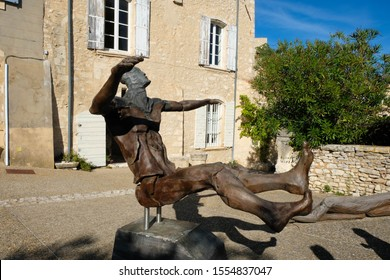Joucas. Luberon. Provence. France. October 05. 2019. Monumental sculpture of a human transformer made of wood and metal in the village square. France tourism.
