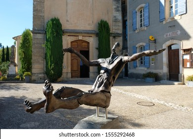 Joucas. Luberon. Provence. France. October 05. 2019. Space man made of wood and metal on the village square. Transformer sculpture. France tourism.
