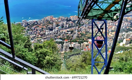 Jounieh Beach past the cable car supports seen from the top of Mount Harissa in Beirut, Lebanon