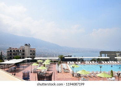 jounieh /Lebanon - 21/8/2018 -The view Swimming pool and Mountain houses and Sea in background in Lebanon