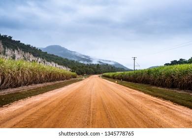 Jourama Falls, Queensland, Australia - 09 June 2018: Gravel road to Jourama Falls leads through cane fields in the Ingham district.