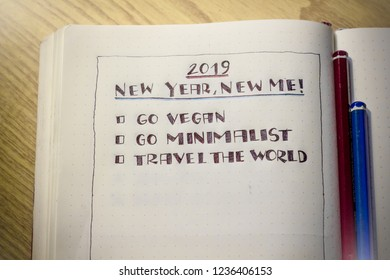 A journal with new year's resolutions written down - 2019