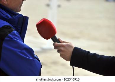 A journalist is making an interview to somebody