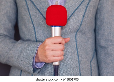 Journalist. Media reporting. Reporter holding microphone.