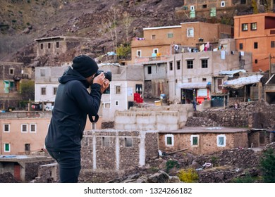 Journalist photograper capturing picture of a typical moroccan remote town in the Atlas mountains Africa