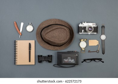 Journalist or private detective workplace - notepad, camera, hat, recorder and other stuff, flat view above