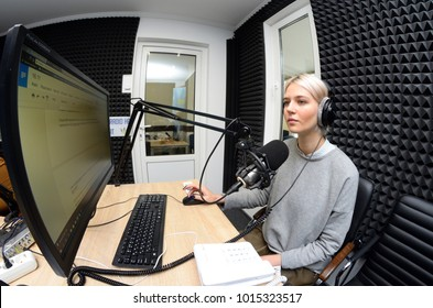 Journalist sitting in front of a computer and broadcasting at a radio studio during radio marathon to Radio Day. November 16, 2017. Kiev, Ukraine