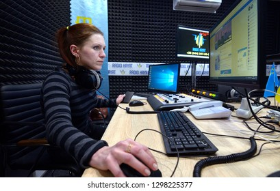 Journalist sitting in front of a computer and broadcasting at a radio studio during radio marathon to Radio Day. January 3, 2019. Kiev, Ukraine