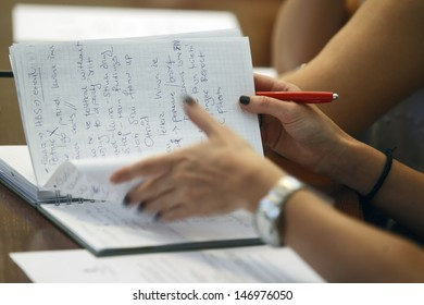 Journalist is taking notes during a conference