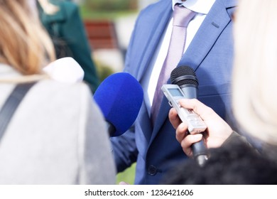 Journalists making media interview with business person or politician