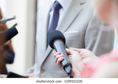 Journalists making media interview with unrecognizable politician or businessman