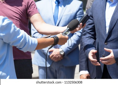 Journalists making media interview with unrecognizable business person or politician