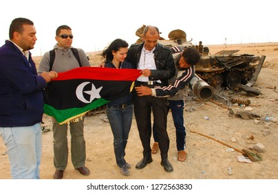 Journalists pose for a photo with Libyan rebels. The Arab Spring begins. Benghazi, Middle East, April 7, 2011