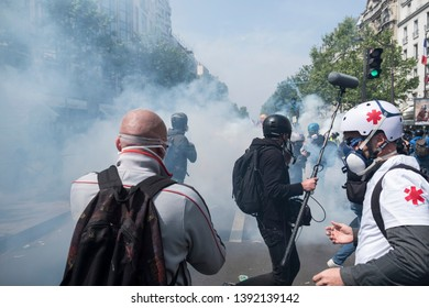 Journalists scramble to avoid the tear gas being fired from French police during the May Day protests in Paris, France. 01/05/19