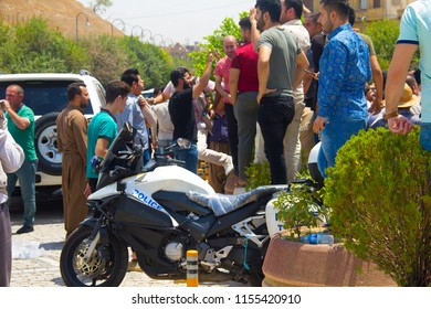Journalists, Soldiers & Spectators gather outside Islamic State Siege at Erbil's Governorate building Erbil, Iraqi-Kurdistan July 23th 2018