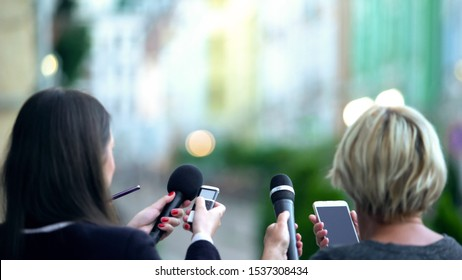 Journalists waiting superstar for interview, holding microphones and dictaphones