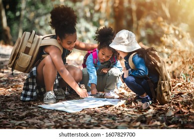 Journey Concept of Explorer Kids Travelling and Hiking in the Forest with Family Among Nature in Vacation Summer